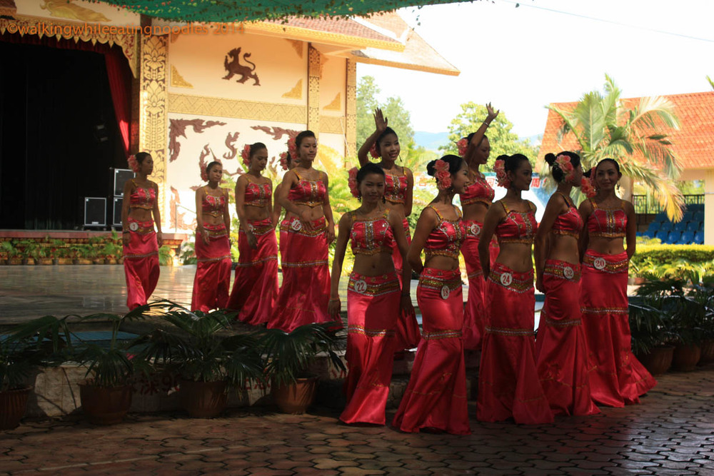 After a few dance numbers which, demonstrated different aspects of the local tradition, the girls reemerged wearing numbers. For 100 RMB ($15) you could buy a fragrant box which is to be worn on the neck of your favorite beauty as your vote for her.