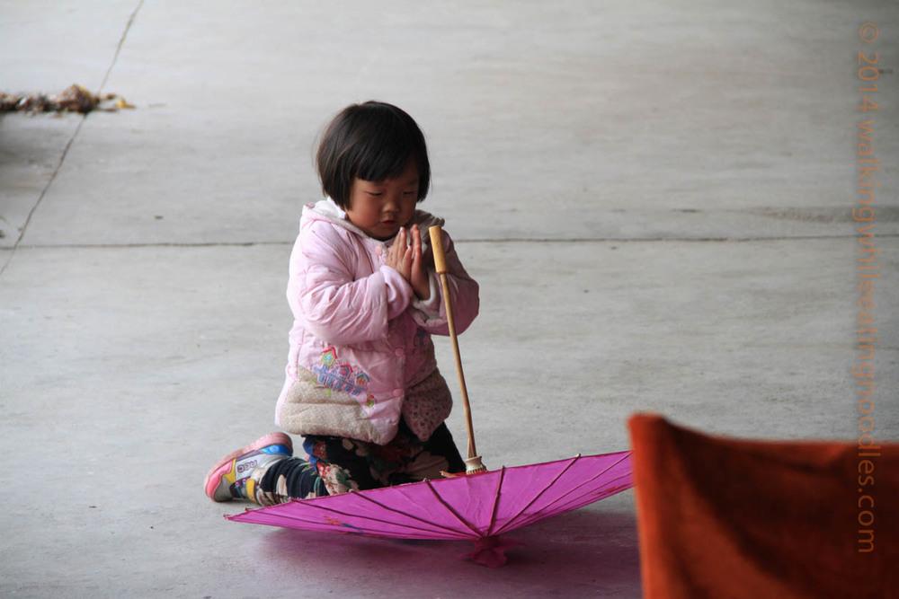 Praying over an Umbrella