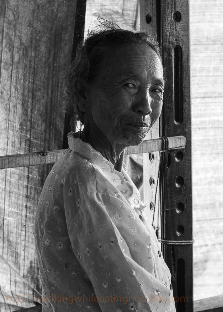 Old-Woman-long-boat-Laos