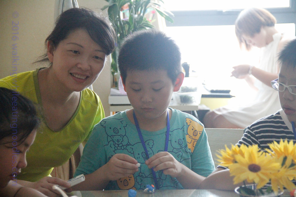 Green with one of the students