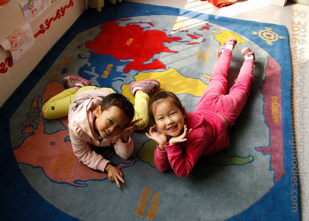 students on globe rug