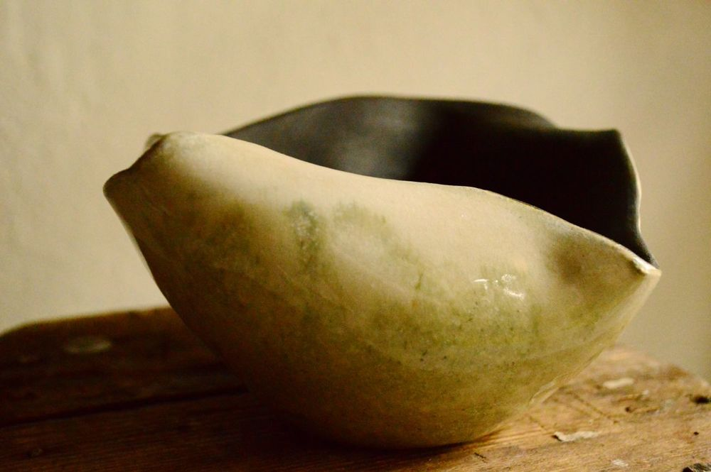 Stoneware bowl, thrown and altered, exterior glazed and interior raw black.