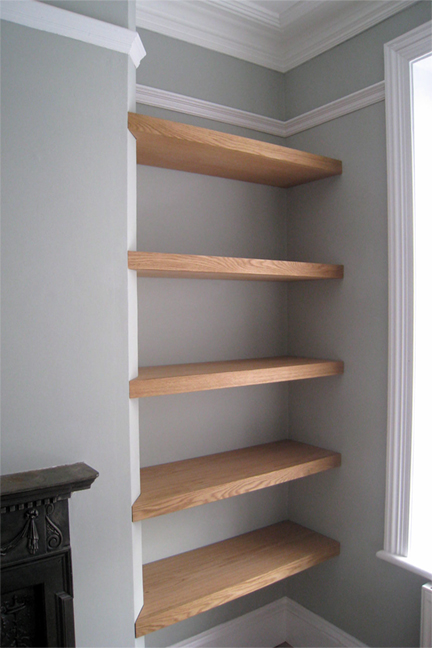bespoke joinery crafted shelving fitted to alcove