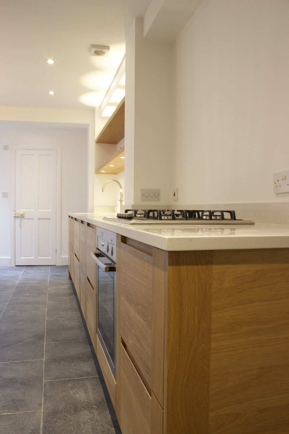 Stone worktop Solid oak cabinets