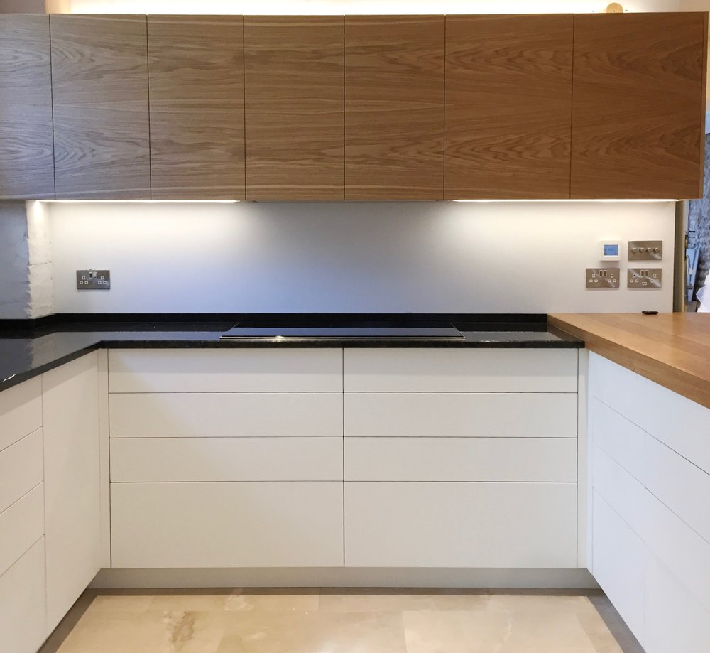 Kitchen Design oak and Corian with lime stone floor