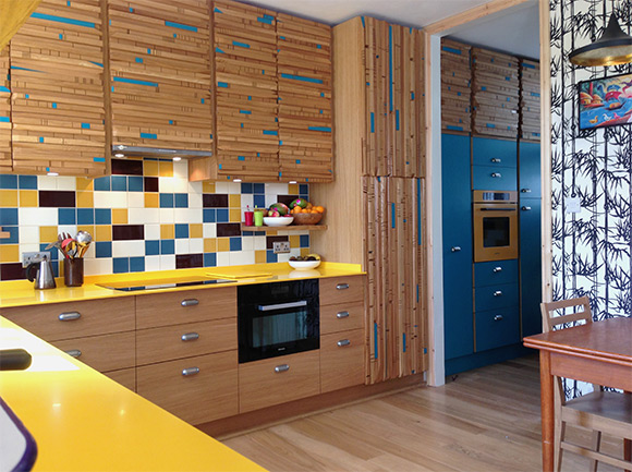 Colourful Corian Kitchen with blue and yellow tiles