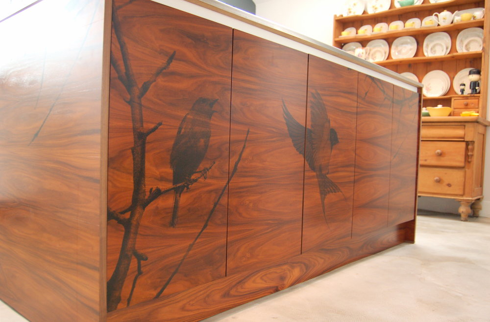Kitchen island made from Rosewood and stenciled with birds designed by Ben Allen