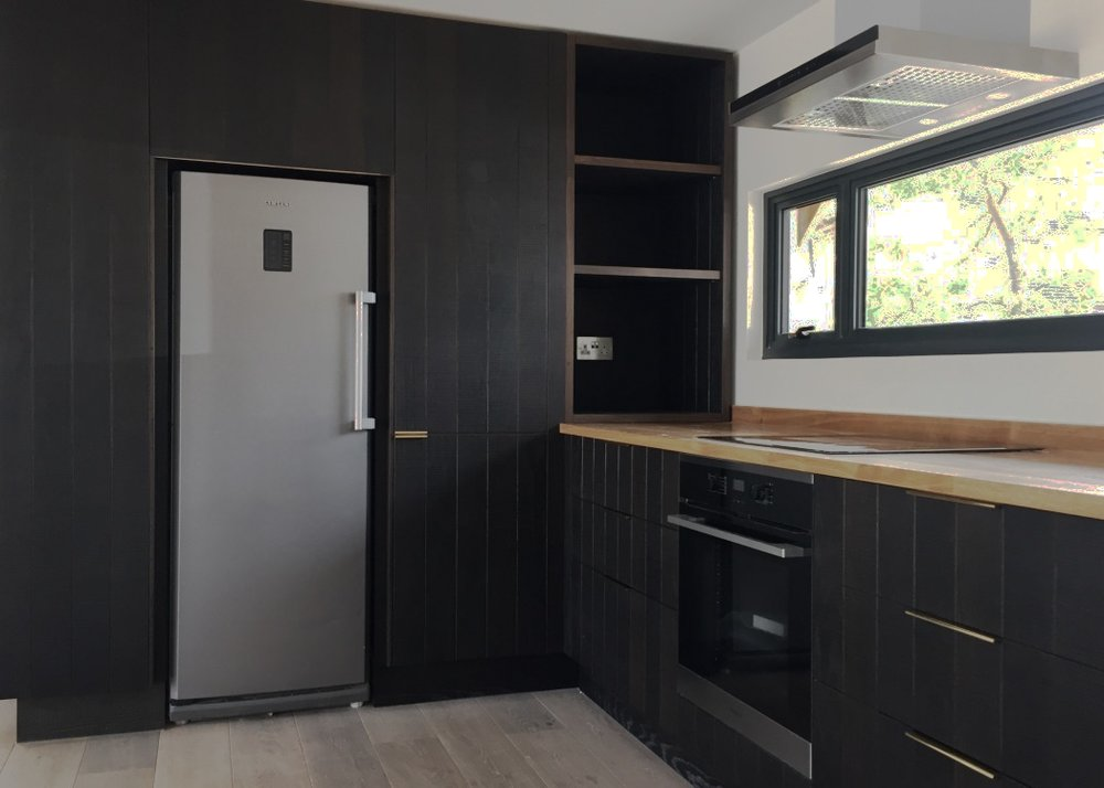 Kitchen Design with fumed oak cabinets and brass handles