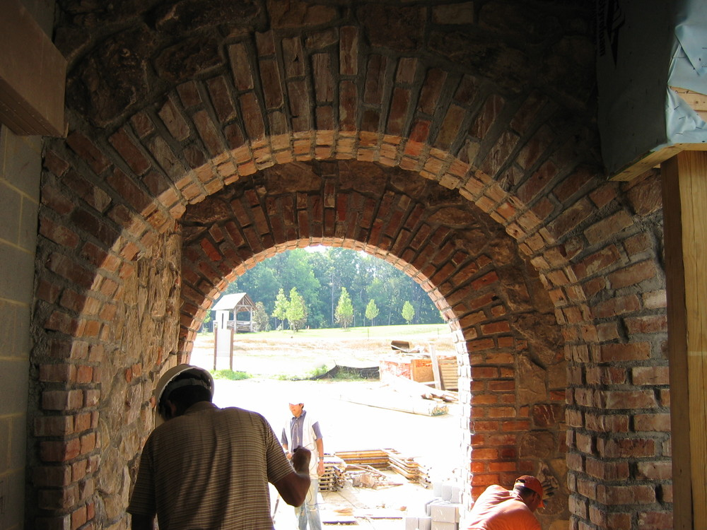 Reclaimed brick arches in residential space