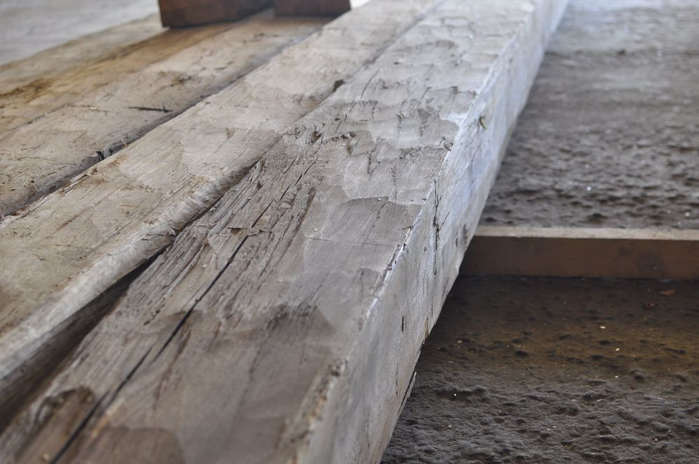 Hand hewn beams salvaged from an early 19th century home.