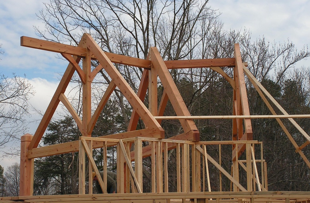 King Post Trusses and timber trim being installed in a residential home.