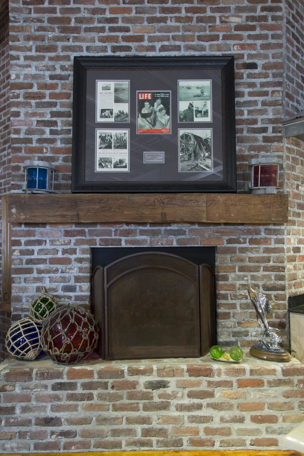 Antique bricks used for a fireplace with a  Reclaimed Beam  mantel