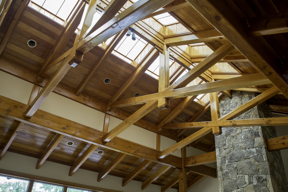 Crossing Scissor Trusses in the Heavy Timber Great Room designed and crafted by Triton