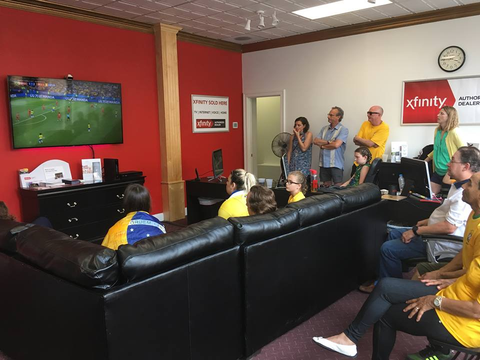 Attendees pensively watch a World Cup match