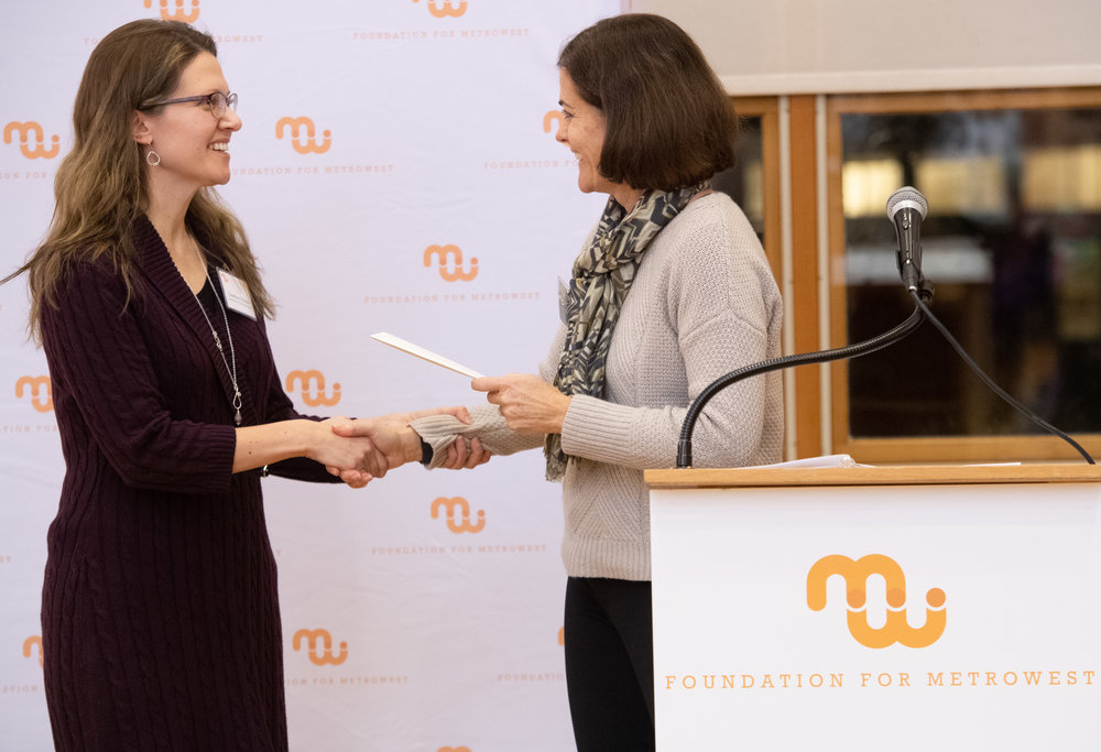 On December 10, Courtney Thraen, Executive Director of Downtown Framingham, Inc., accepted the award at the Foundation for MetroWest Gala.  Photo Credit: Scott Metzger