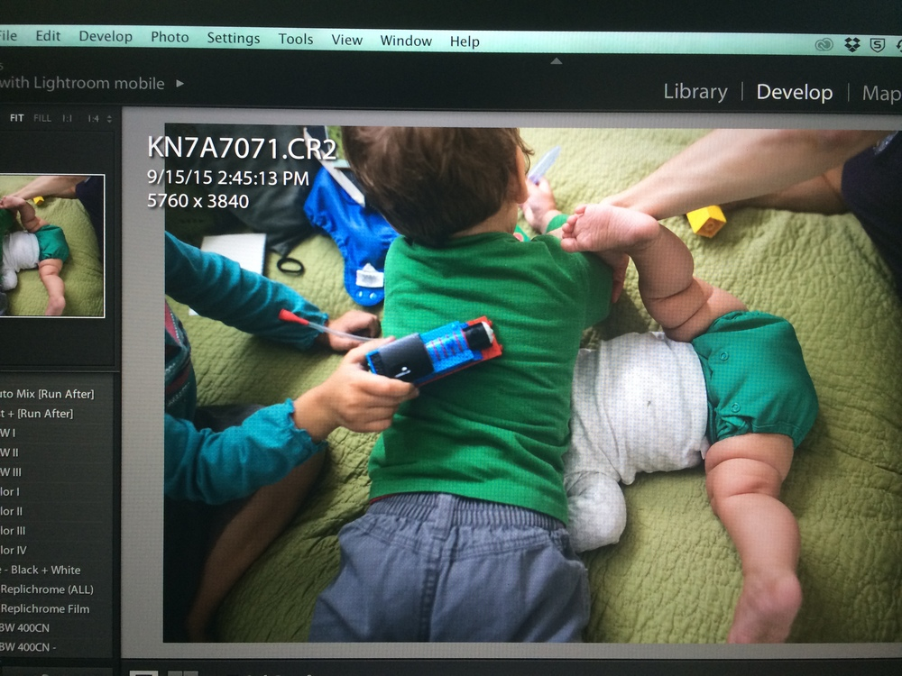 a (raw, unedited) screen shot Suzanne sent me of one very real family moment from our session : the one in which Gus laid on top of Walt's head, while Hazel drove a train over his back. that's my arm in the top right, sweeping in to pull Gus off his brother's face lest he suffocate him.