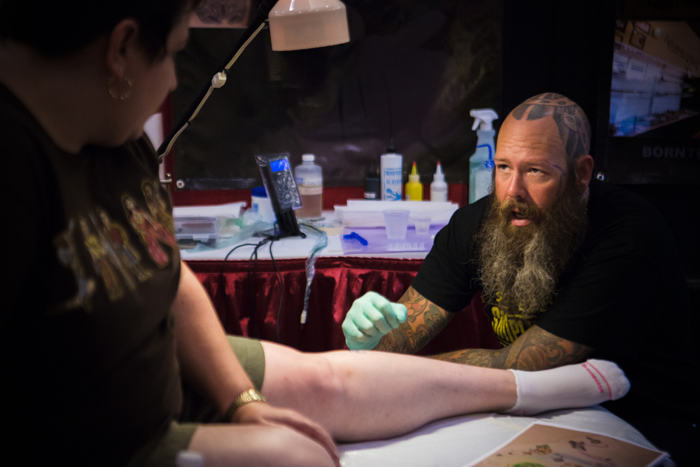 Rick Levenchuck of Born This Way Body Arts in Knoxville, TN consults with a client.