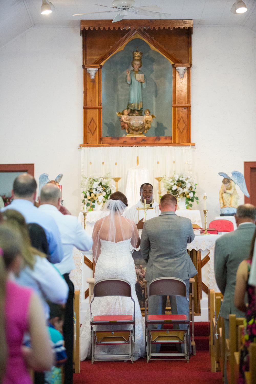New-Mexico-wedding-couple-before-altar-santo-nino