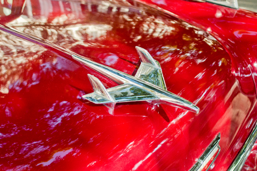mark_HOOD ORNAMENT ON RED CAR2.jpg