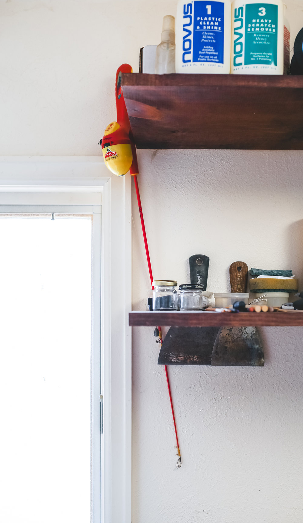 THE fishing pole that sparked Jim's imagination hanging up in his studio as a constant reminder of his new art form.