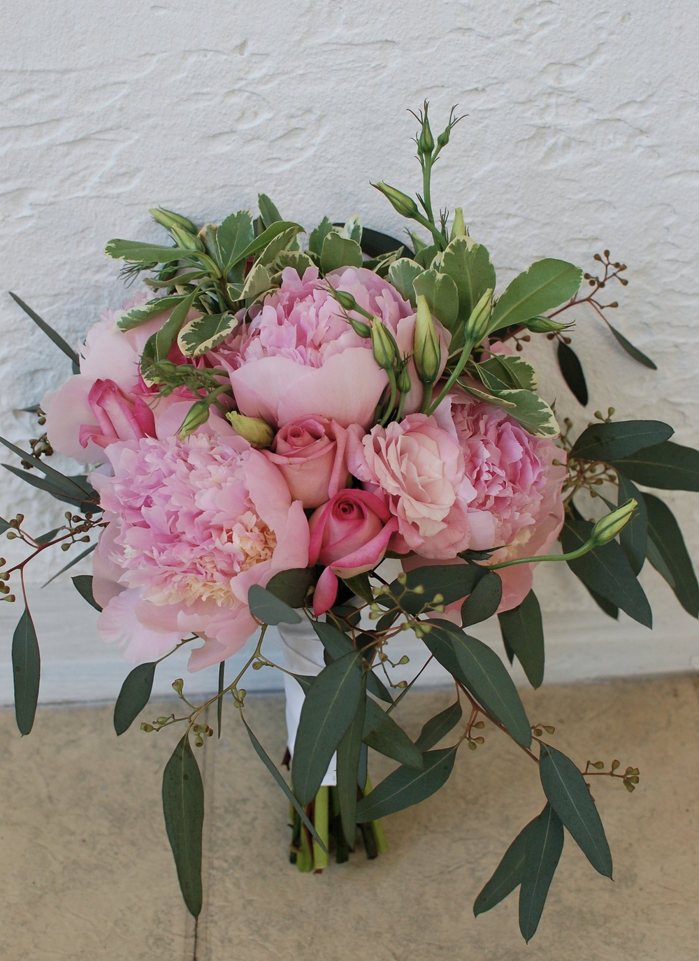 Peonies, roses, lisianthus, and seeded eucalyptus