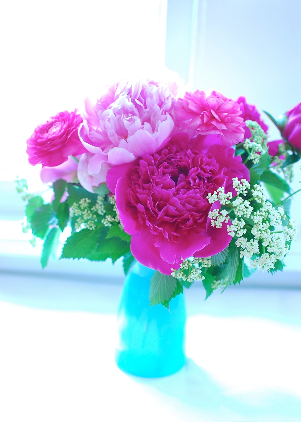 Peonies, ranunculus, and some greenery