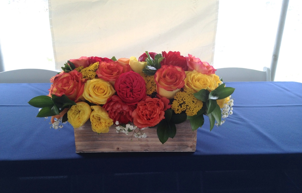Head table flowers in whitewash wood box.