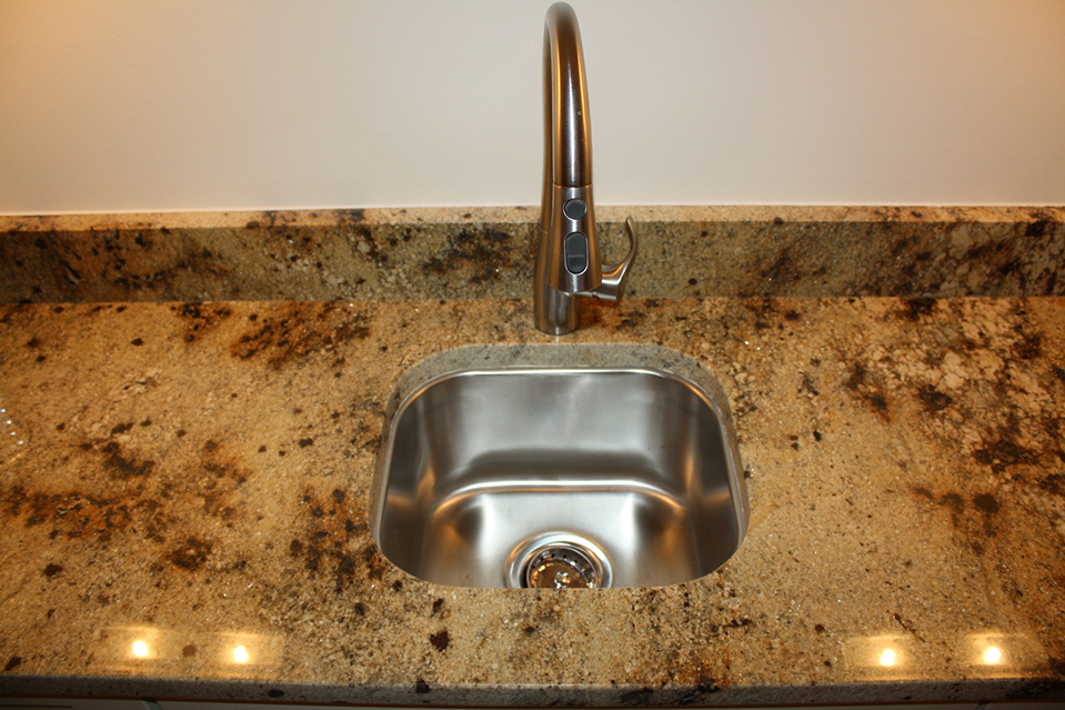 Stainless Steel Sink with Granite Countertop.