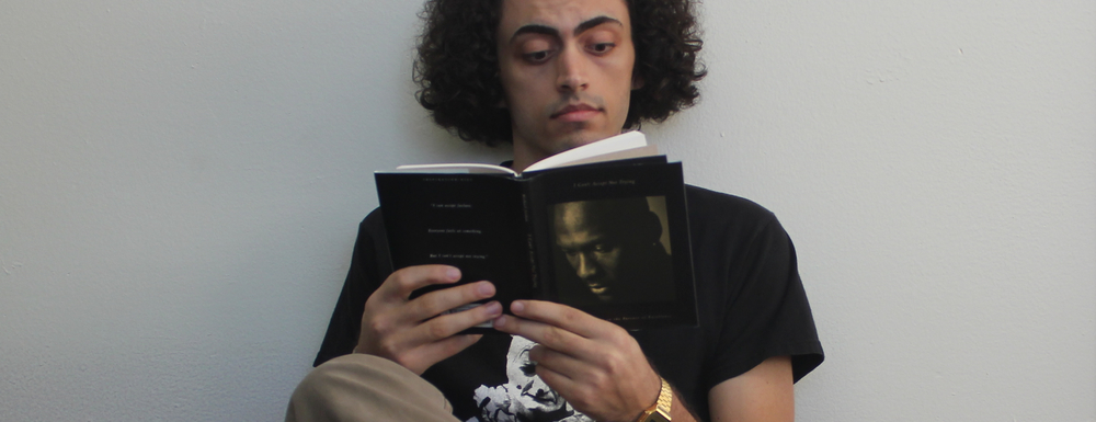 """Candid shot of me reading Michael Jordan's """"I Can't Accept Not Trying."""" His words and jeans are an inspiration."""