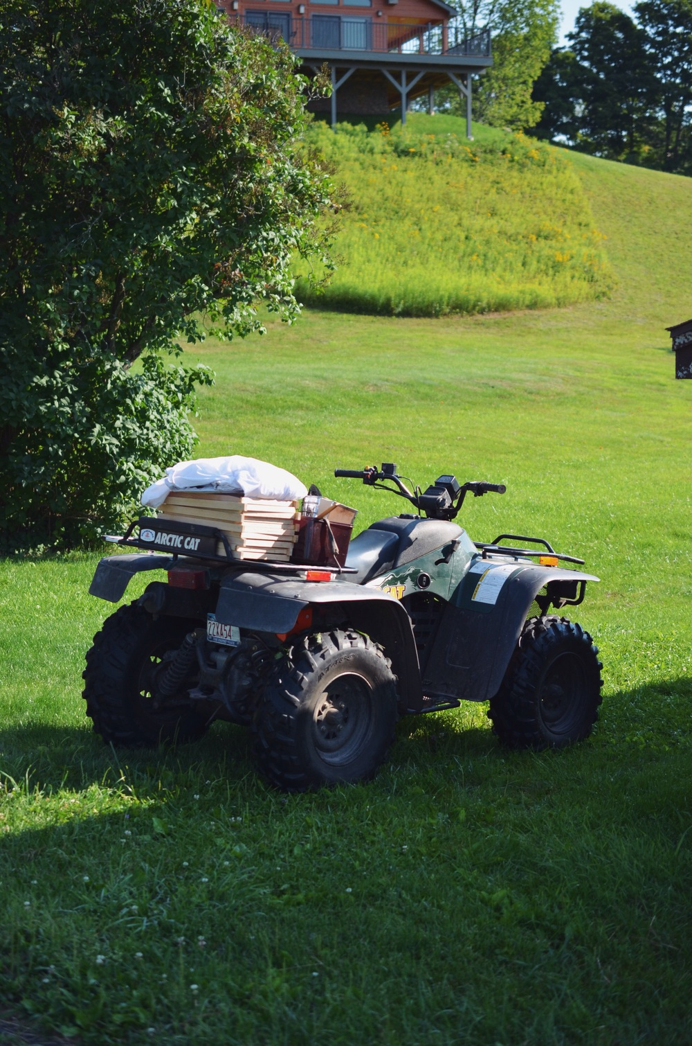 Loading up the ATV with bee supplies