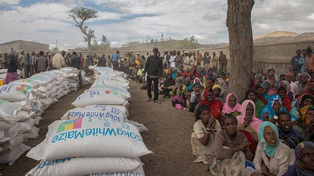 Ethiopians in the rural Ziway Dugda district await distribution of emergency food aid in January.   Mulugeta Ayene/A