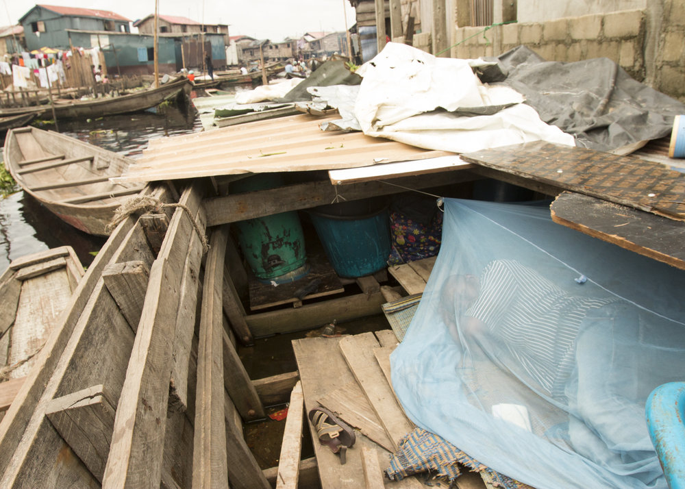 Salako Hunsa lives in a canoe in the Makoko waterfront settlement in Lagos, Nigeria. His home was burned down last month. (Tim McDonnell)