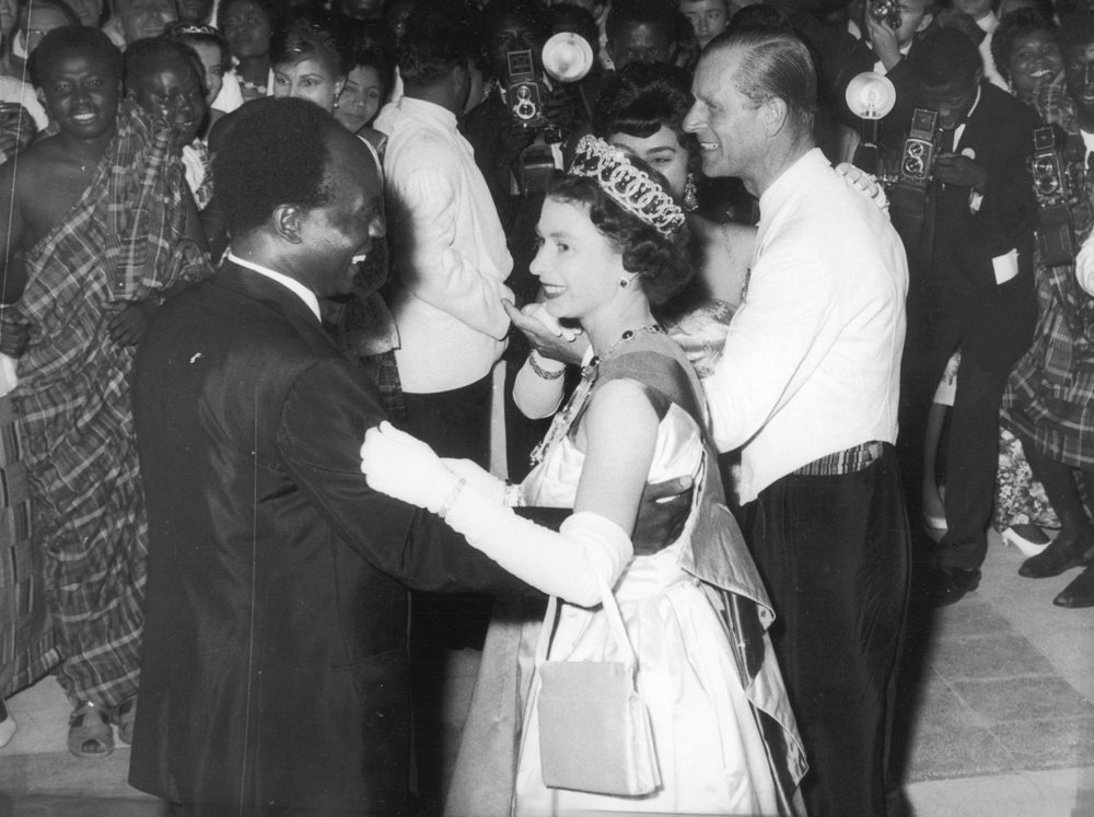 Queen Elizabeth II dances with Ghanaian president Kwame Nkrumah at a ball in Accra, Ghana, in 1961. (Central Press/Getty Images)