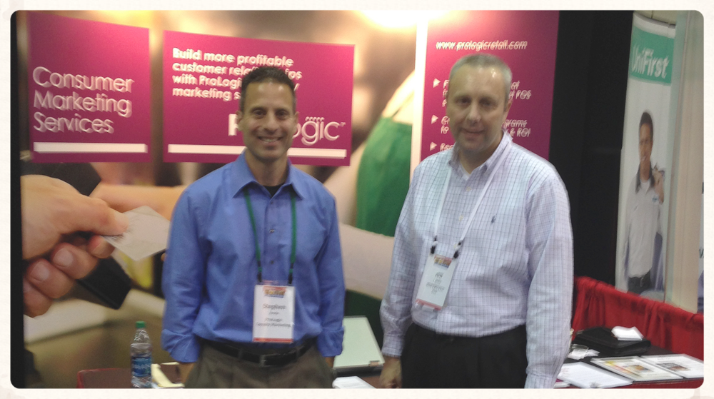 Bill Lipsky of Supervalu and Steve Avola from ProLogic share a moment in front of the ProLogic booth.