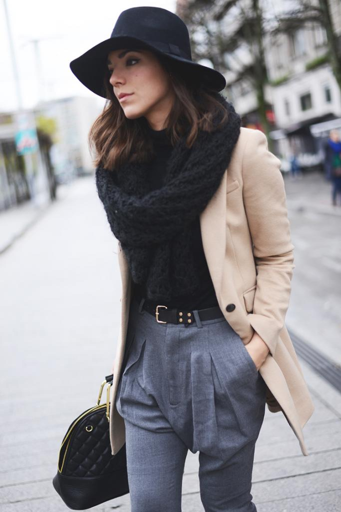 "These grey ""baggy pants"" look incredibly comfortable all the while maintain the professional and respectful front pleat. By combing slouchy or baggy pants with a camel jacket and belt the look is made more chic and less EEK. (From:   thefashionthroughmyeyes.com  )"