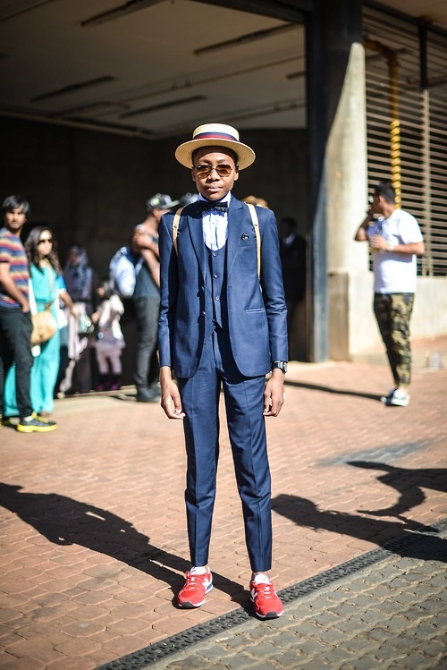 Although I'm not completely sold on pairing a suit with tennis shoes, this look sells itself. The added details of the three-piece suit and straw boater really bring up the appeal and make this ensemble a winner on and off the track. (From:  blackfashion.tumblr.com )