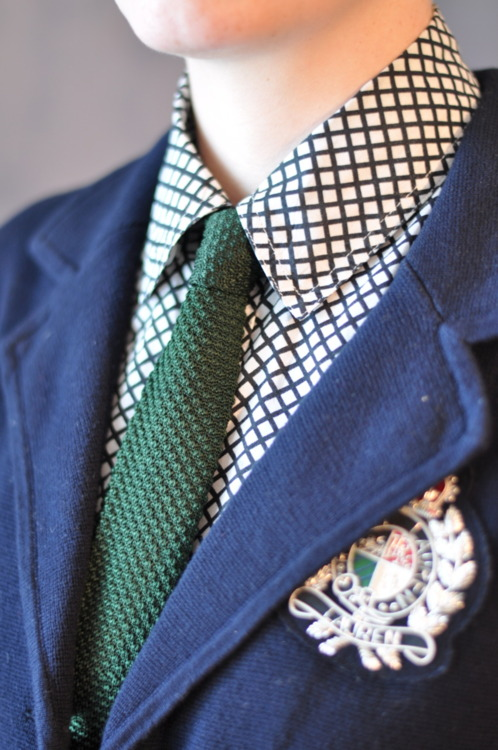 A Tumblr favorite  Mimi , cofounder of  Midwest Queer Fashion . Navy Blazers with brass/gold-toned buttons are quintessential to American Prep. Deep emeralds and maroon accents make for a timelessly elegant option for any one of your four season affairs.
