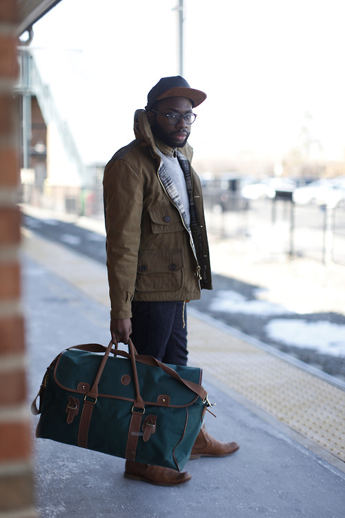 A large duffel is a great, more office friendly alternative to a backpack. It's also a nice switch up from a briefcase. If I had a job, I'd own one. But overall, the look is on point. Honorable mention to the snapback-just beautiful | From: blackfashion.tumblr.com