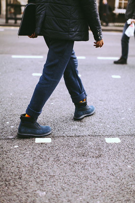 Navy wool pants, matching navy boots, and orange socks? Yum! | From:  blogs.nordstrom.com