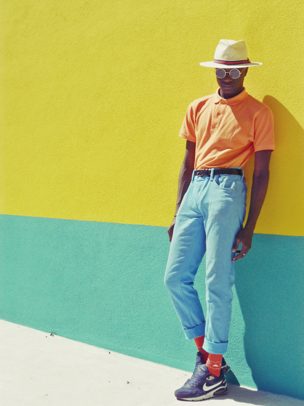 This is just so retro, I can't even handle it. And I love the two-toned outfit against the two-toned wall.  Abdel, Lisbon , Photographed by Luís Areias | From:  blackfashion.tumblr.com