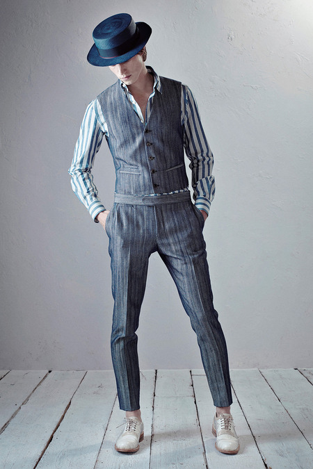 I love the entirety of this collection, which seems to me to combine an Italian cut with a more old-English aesthetic. In this particular look I love the understated pattern of the suit with the flashier shirt. | From: style.com