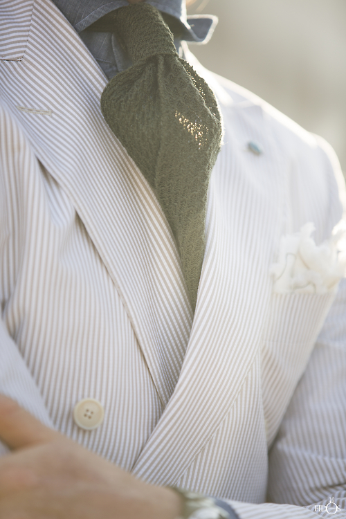I love this twit on the traditional seersucker garb. The olive tie reallymakes the look. | From: thisisrome.net