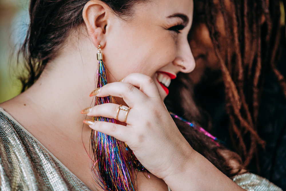 "- I ordered the rainbow tassel earrings on a whim and realized they were the perfect piece to tie it all together."" — Alysse"
