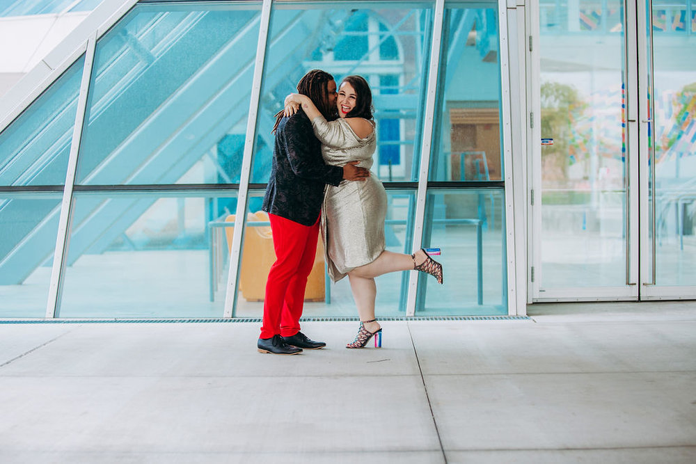 "- ""I had been sent the shiny Rachel Roy dress from Macy's and I realized that it would actually be a perfect bold neutral for the engagement shoot. I knew I had the multi-colored glitter shoes so I wanted something that would match but not distract from that."" — Alysse"