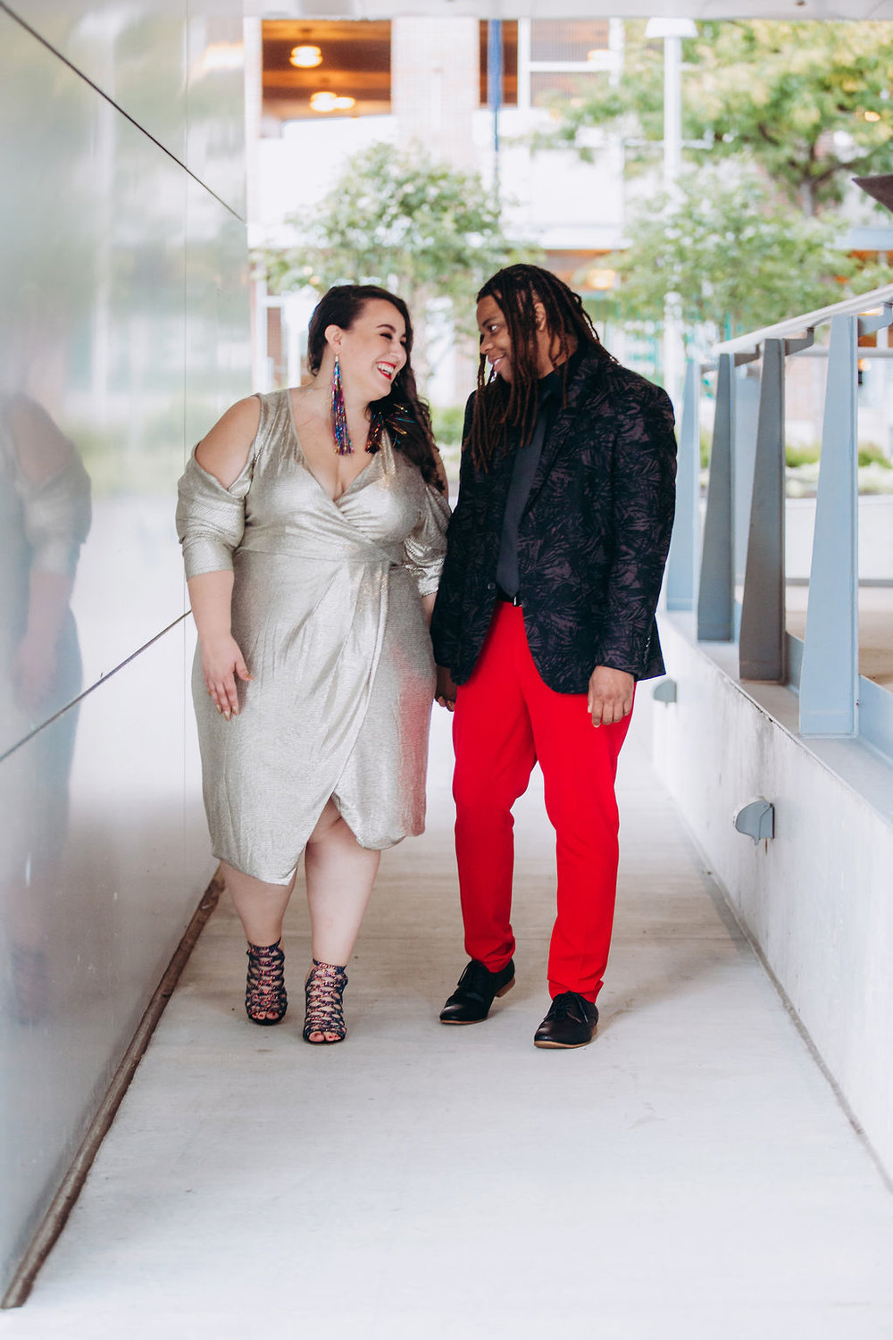 "- ""I love the color red, so it was an easy choice to wear the pants. Finding the the perfect red pants was actually the most challenging part. We looked everywhere in person for them but ultimately, we ended up finding them online at ASOS."" — Gio"