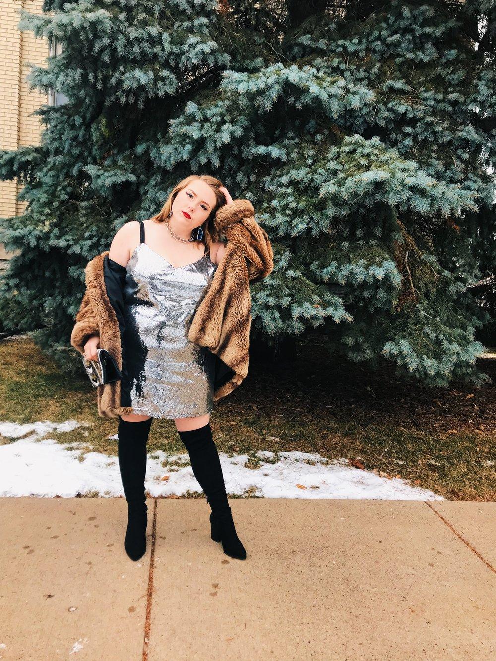 Silver Glimmer - Model: Cody FlahertyDress: TargetPurse: ThriftedCoat: Community Clothing SwapNecklace: Forever 21Earrings: BaublebarBoots: Nordstrom Rack