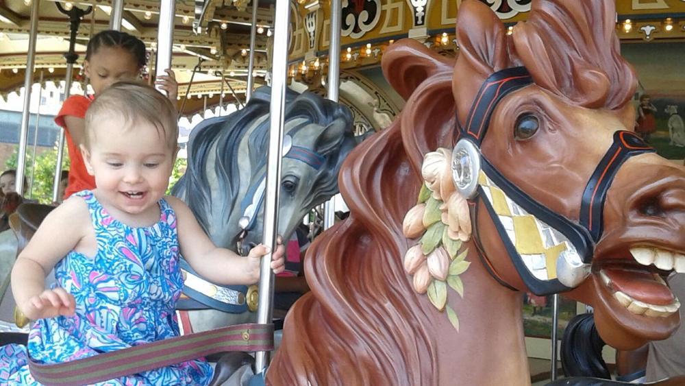 Riding Jane's Carousel in Brooklyn Bridge Park in Dumbo