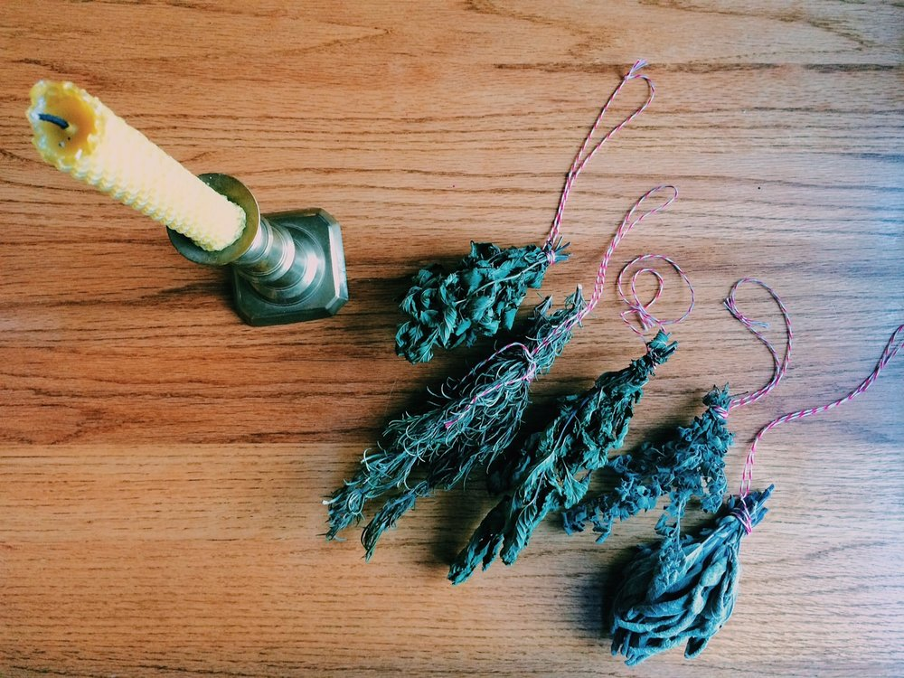 using our handrolled beeswax candles and dried herbs from the garden