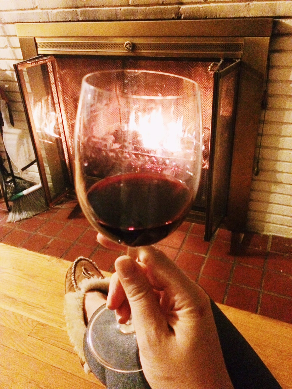 a glass of aglianico by the fire
