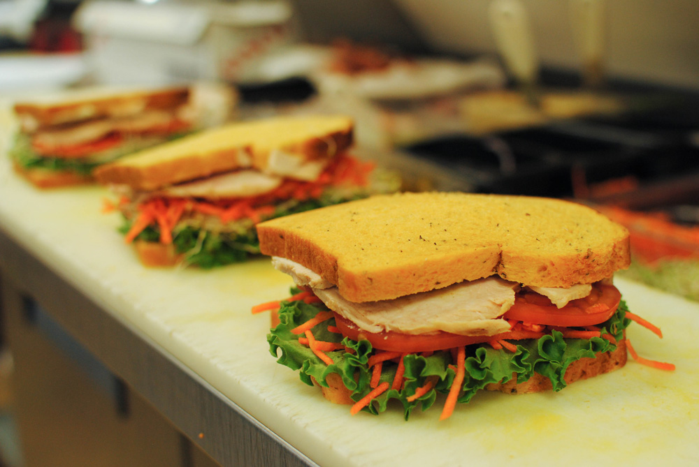 Oven roasted turkey with lettuce, tomato and carrots on Tomato Herb bread.